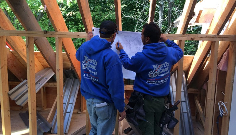 Anthony and Robbie looking over framing plans.