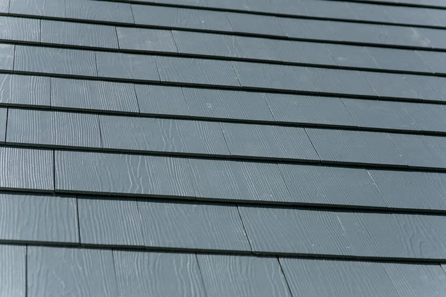 Cedar siding vs fiber cement pros cons the verdict for Fiber cement composite roofing slate style
