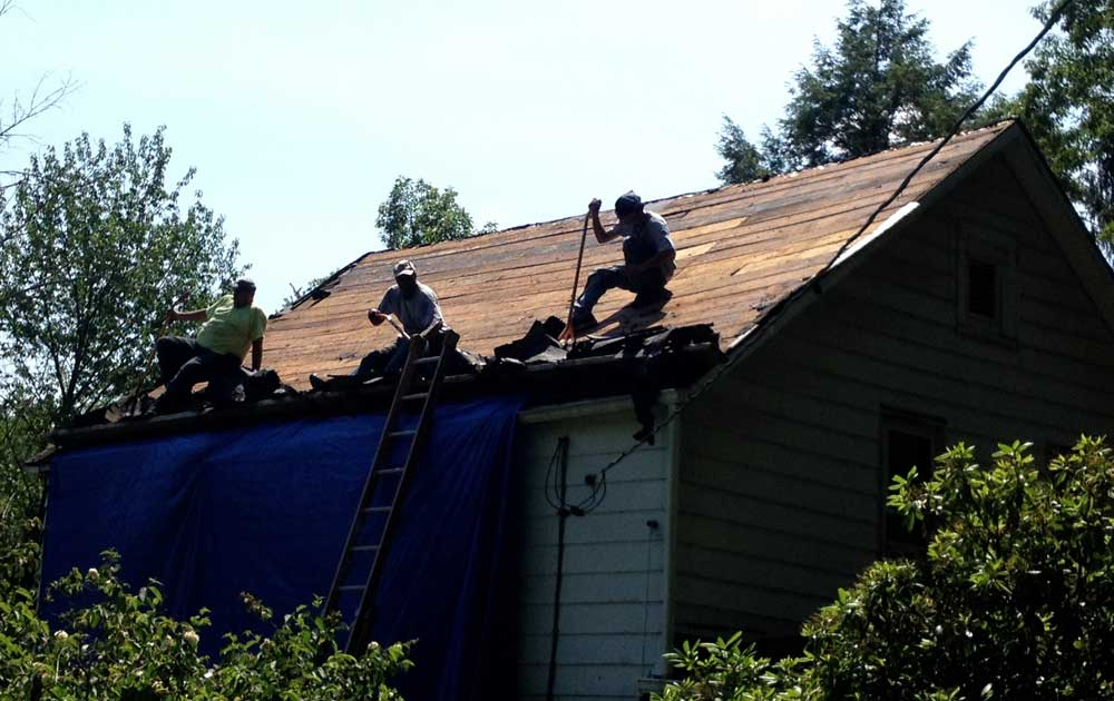 Roofing contractors on roof