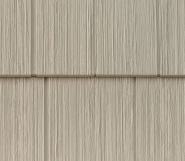Vinyl shingles, look like wood, feel like wood, without the maintenance expense.